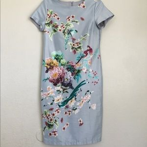 Dresses & Skirts - Baby blue silky dress with designs!